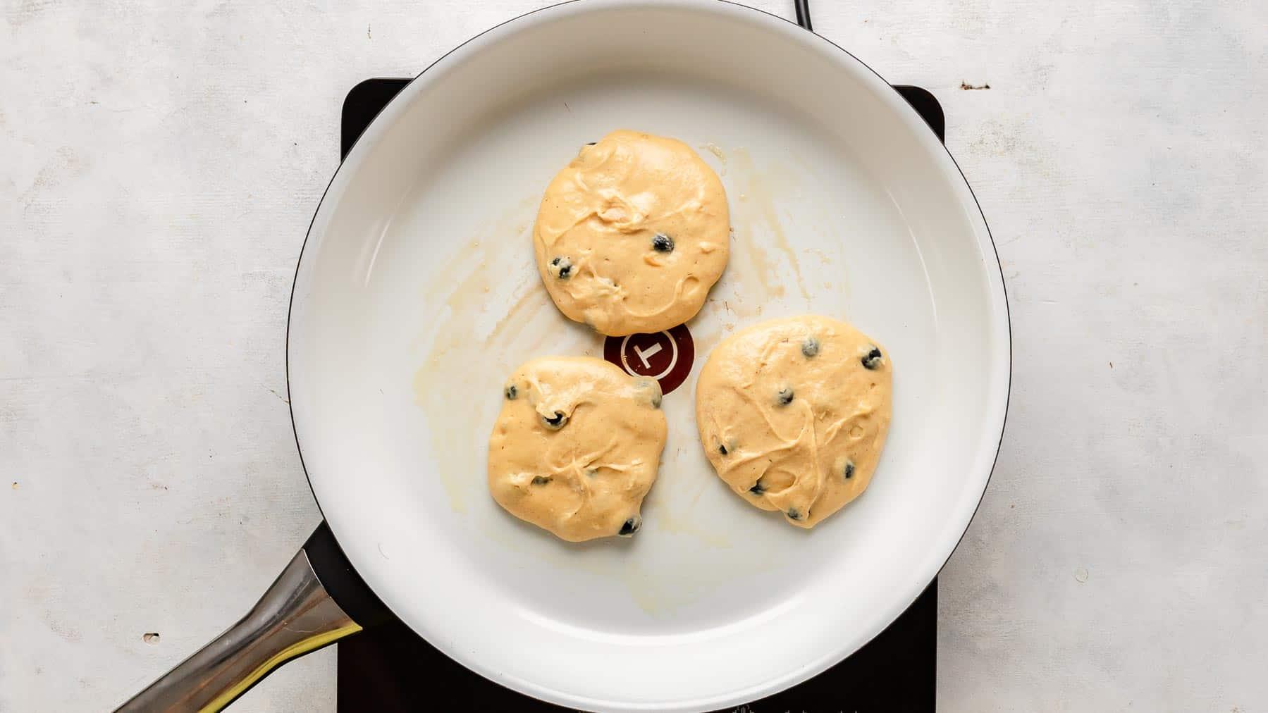 pan with three pancakes in pan