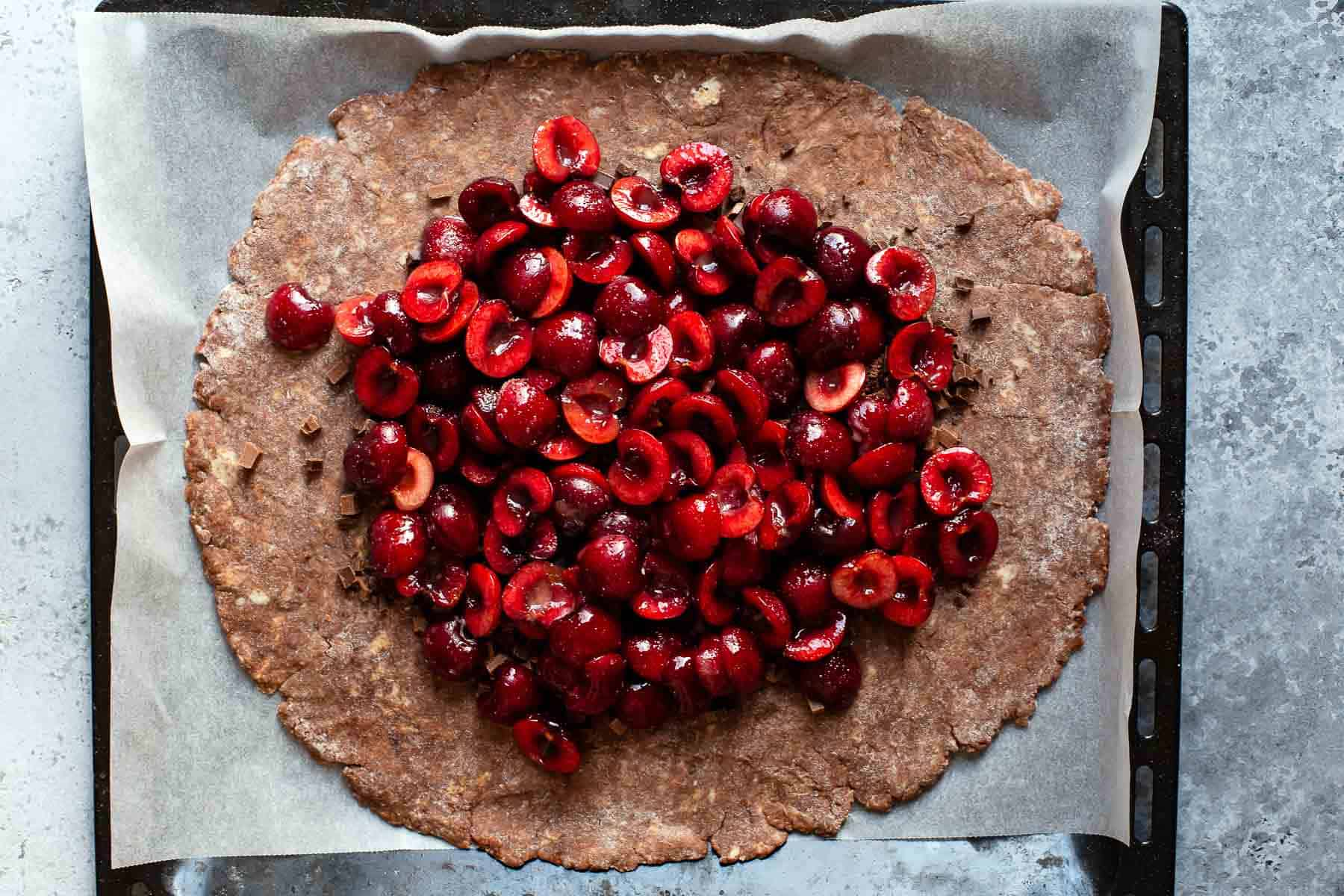 cherries on top of a chocolate pie crust