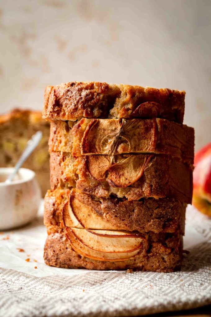 Stacked slices of apple bread on a table