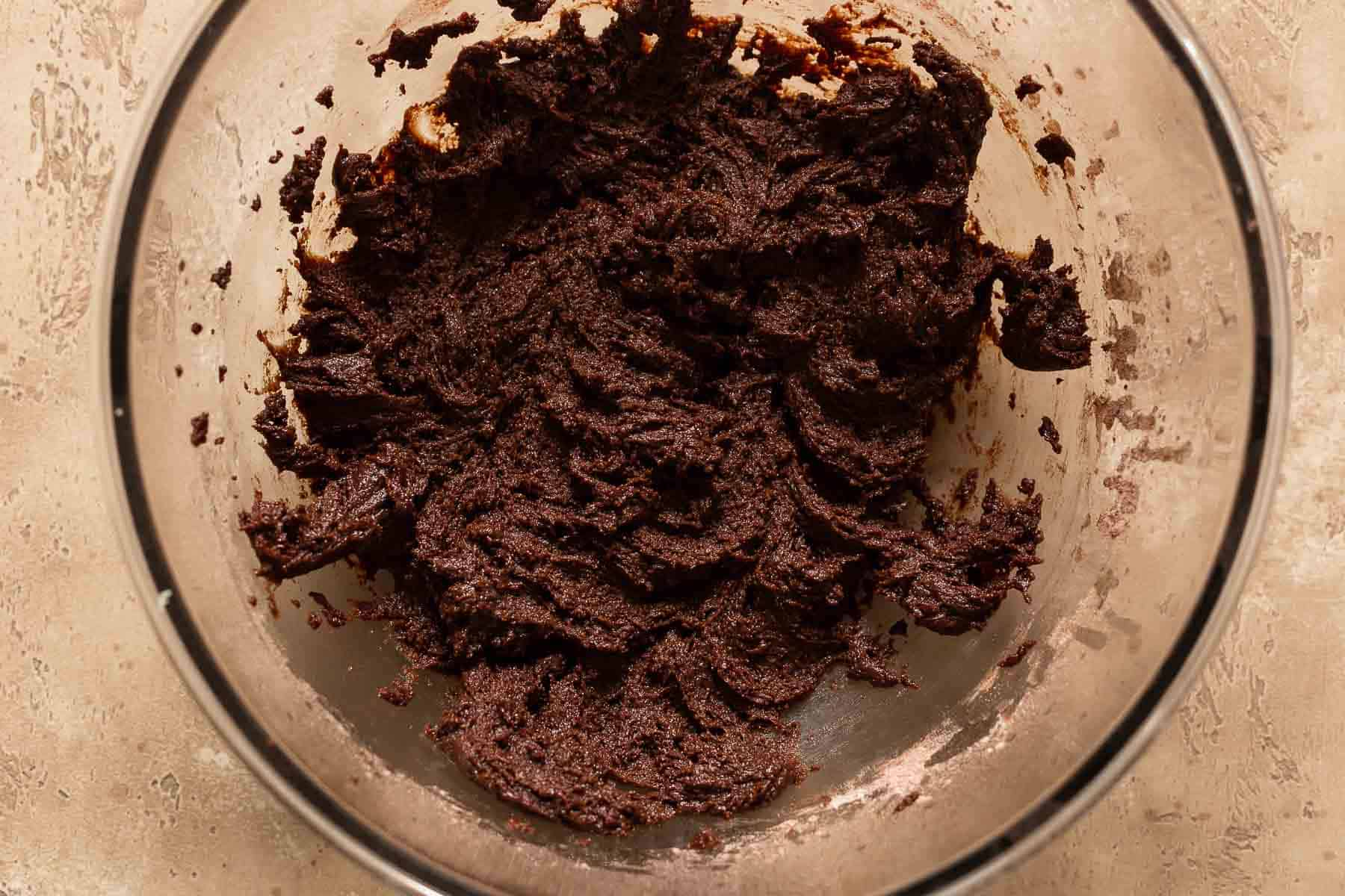 mixing up brownie cookie batter in bowl