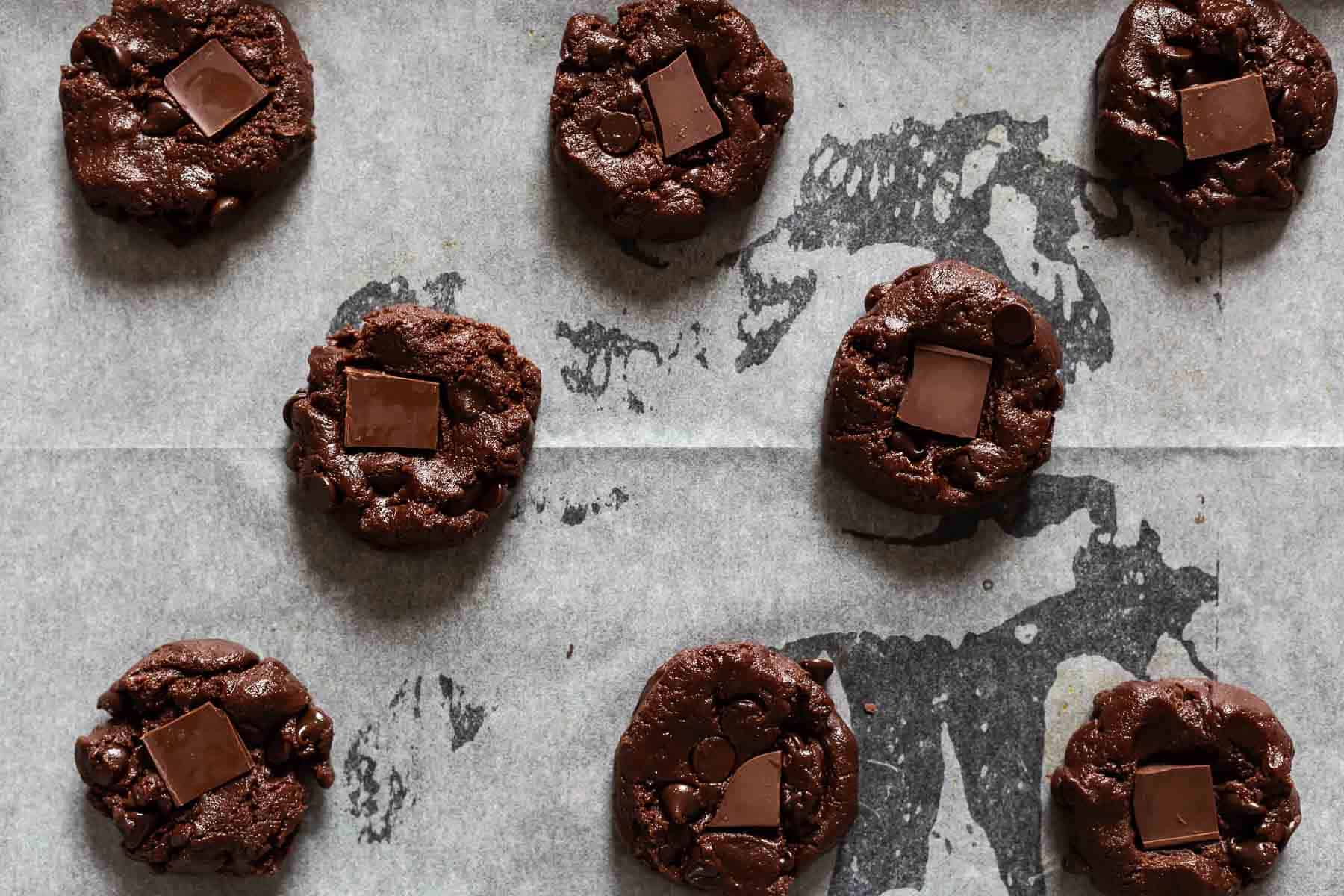 chocolate fudge brownie cookies on parchment paper