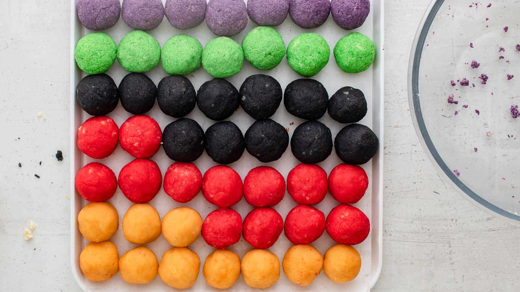 rolled cake balls on a pan