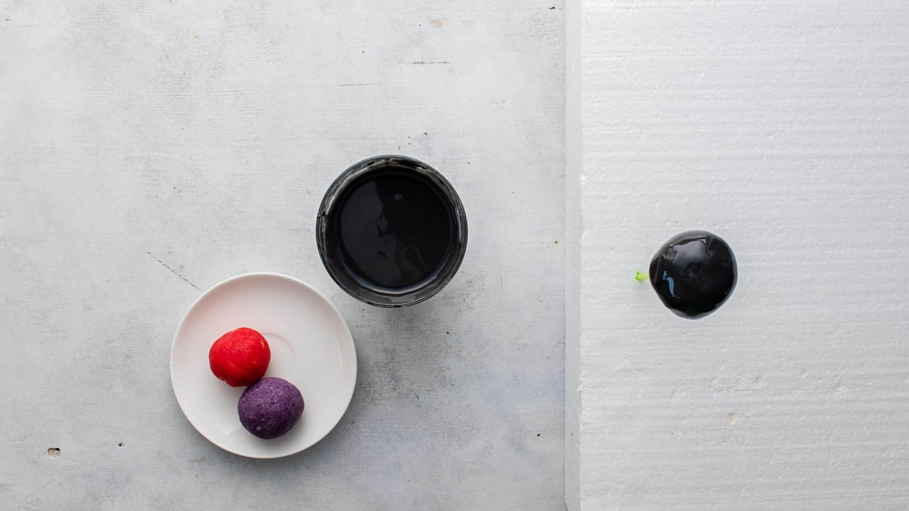 dipping cake balls in coloring