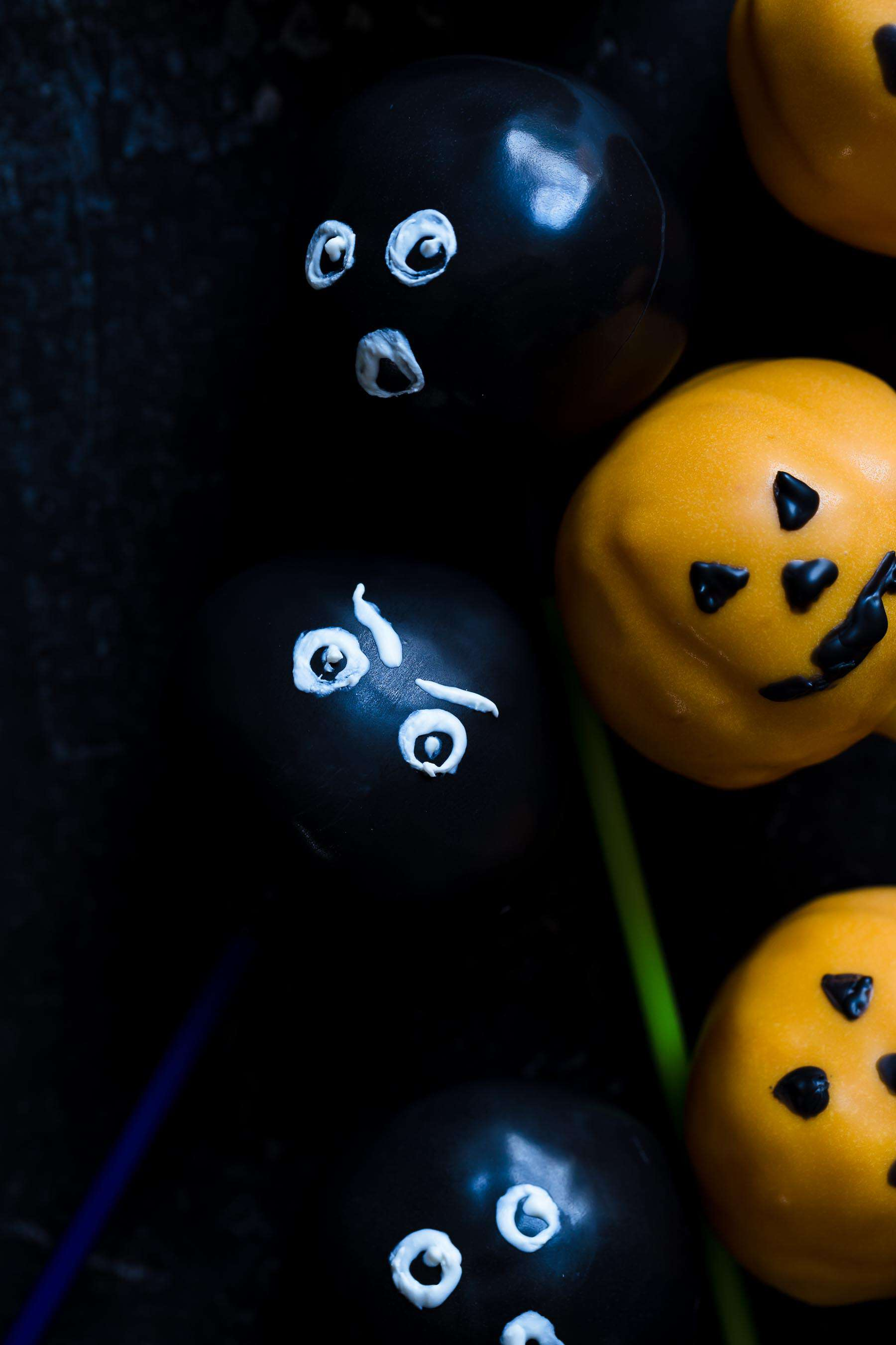 halloween cake pops on a counter