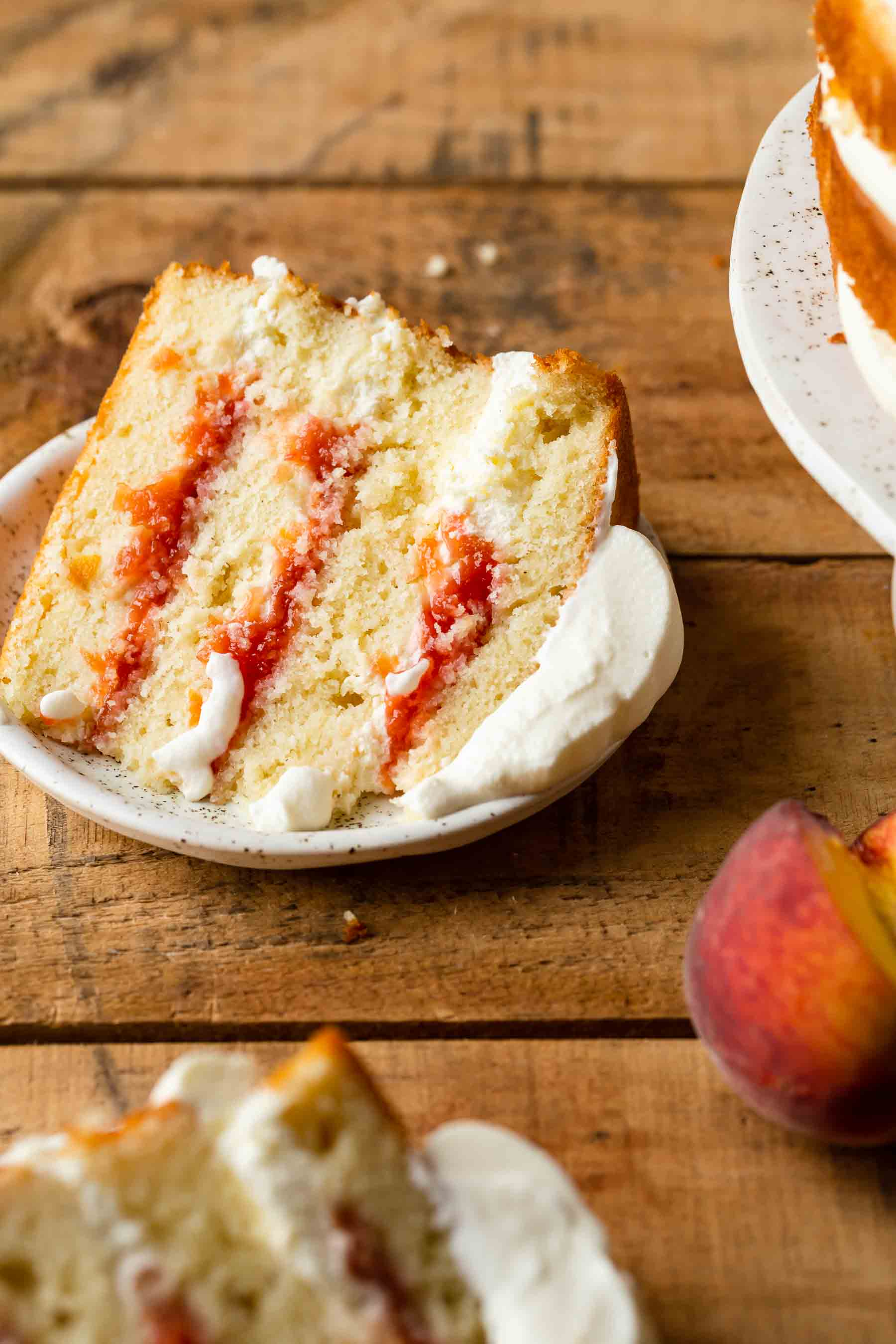 layered fresh peach cake on wooden table
