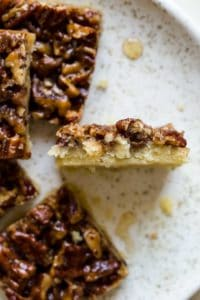 bitten pecan pie bar on white plate