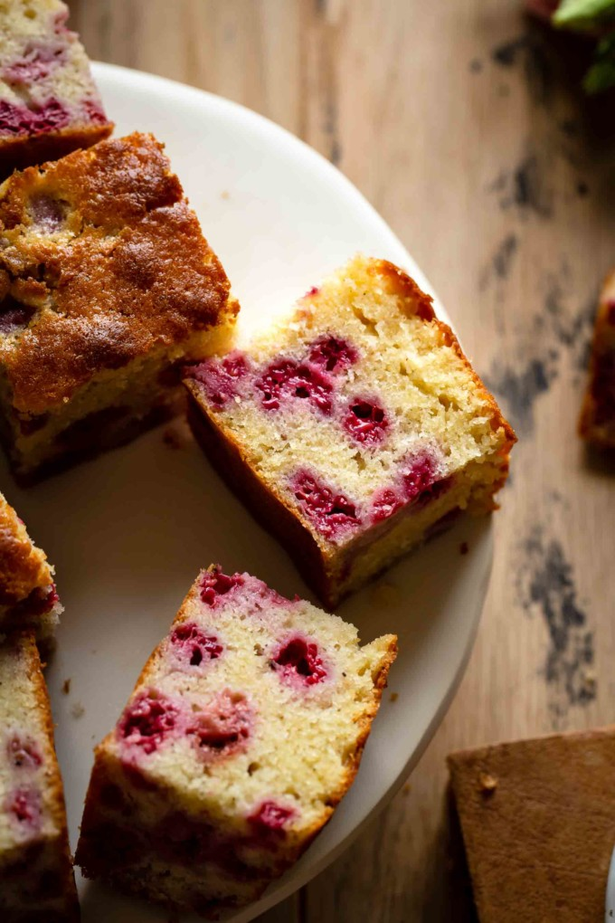 Cut raspberry cake slices on a serving plate