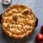 Decorative picture of apple pie sitting on counter
