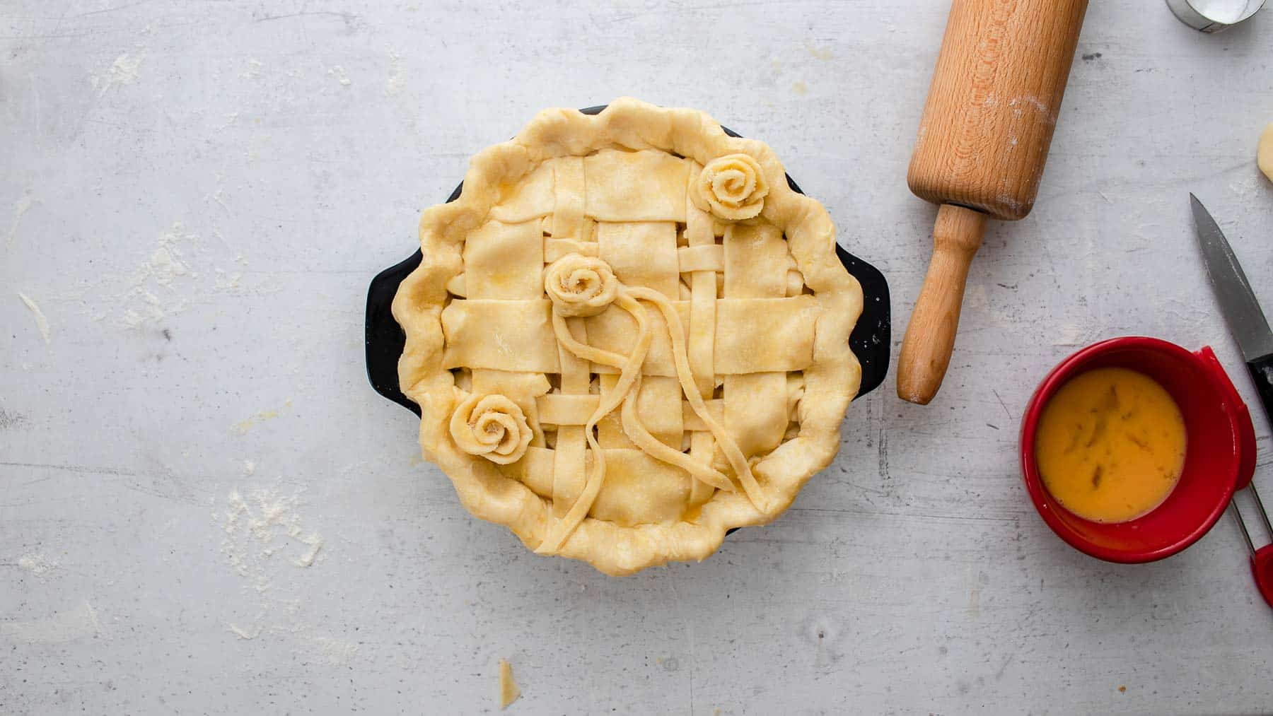 designed homemade apple pie on counter