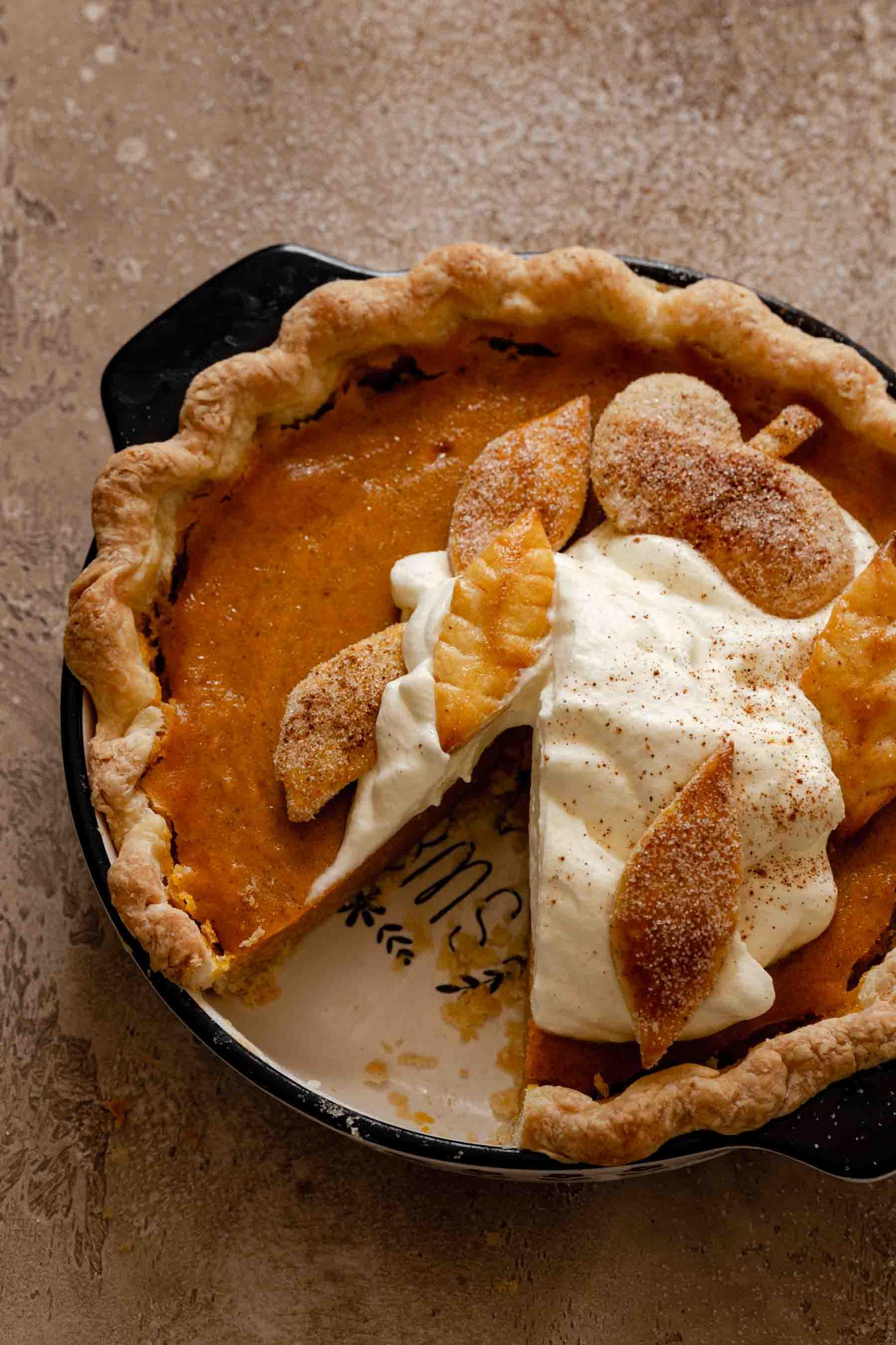 piece of pie sliced out of pumpkin pie