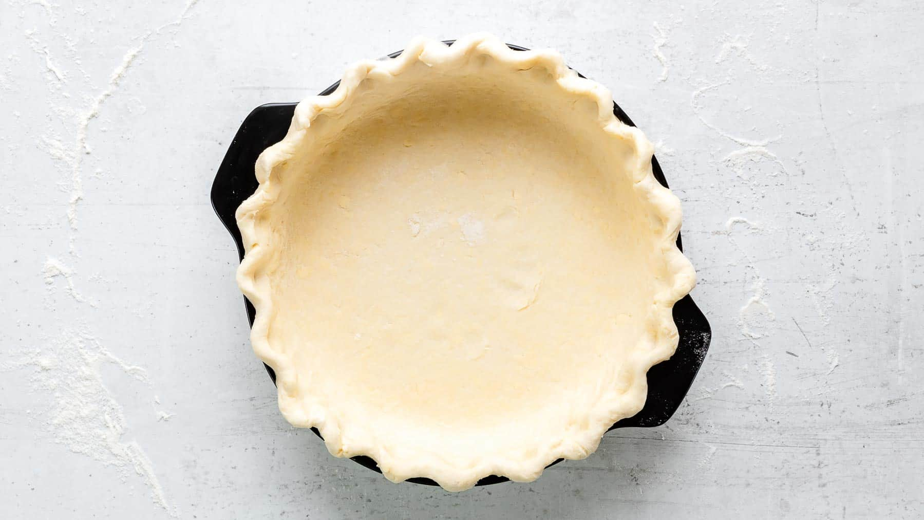 pressed pie dough in pan