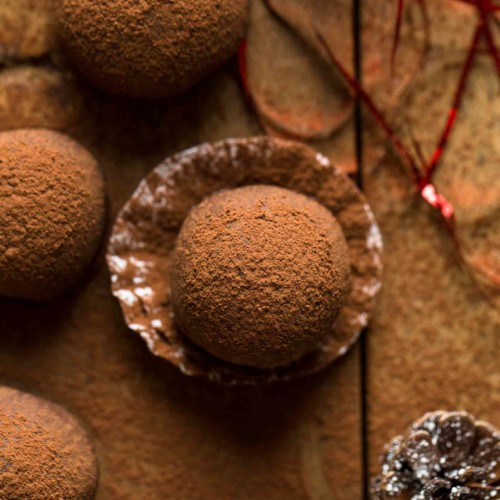 several chocolate rum balls ready to serve