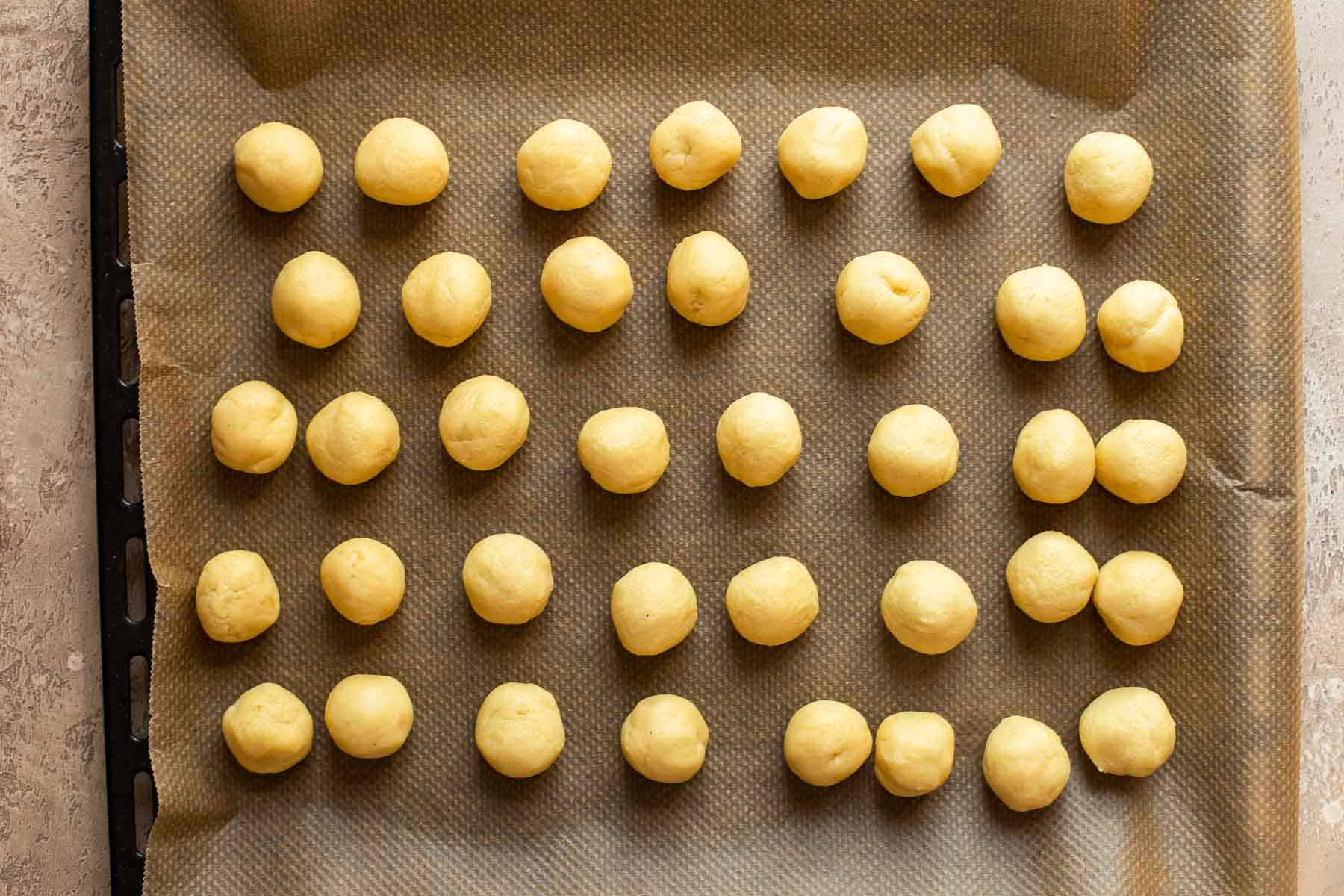 thumbprint cookie dough rolled into balls