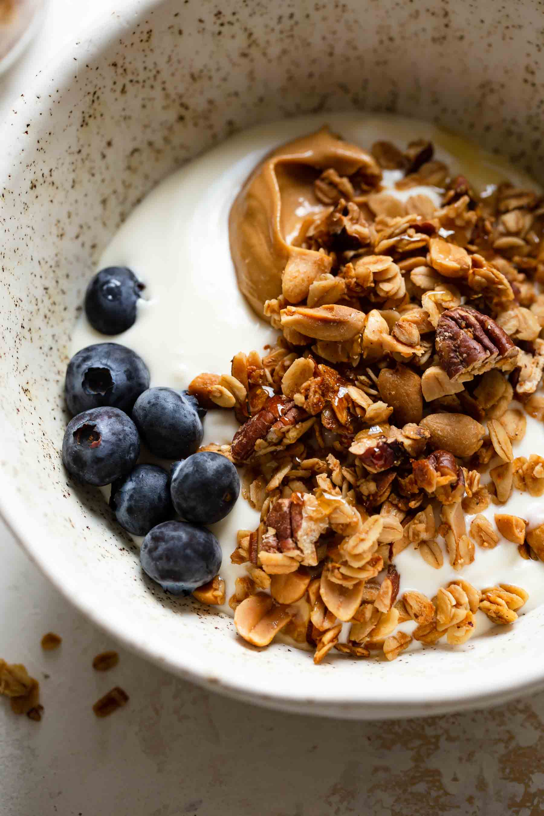 granola in a bowl of yogurt