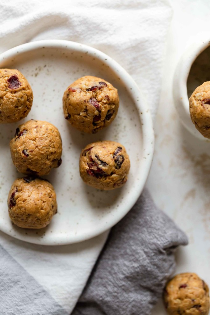 several peanut butter balls on plate ready to eat