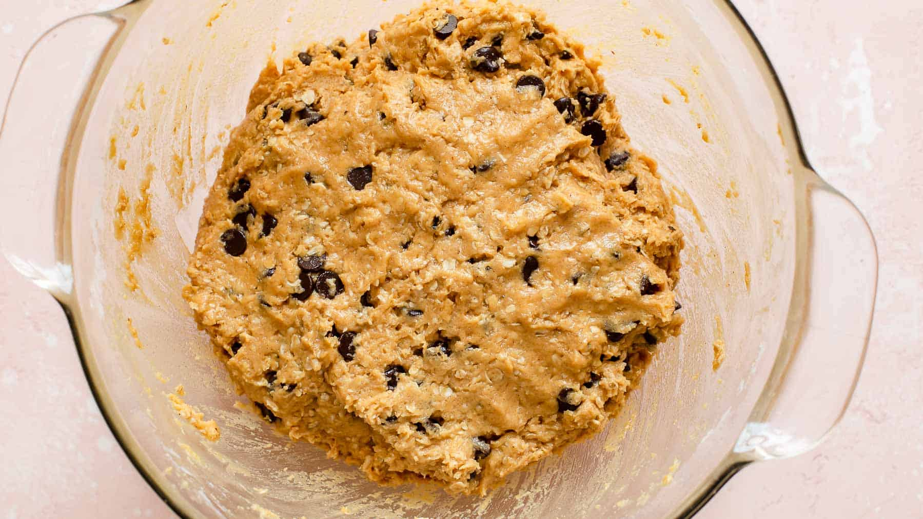 cookie dough in glass bowl on bright surface