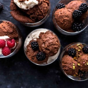 Decorative picture of chocolate mousse in glasses on blueish background