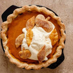 Decorative picture of pumpkin pie on brown background