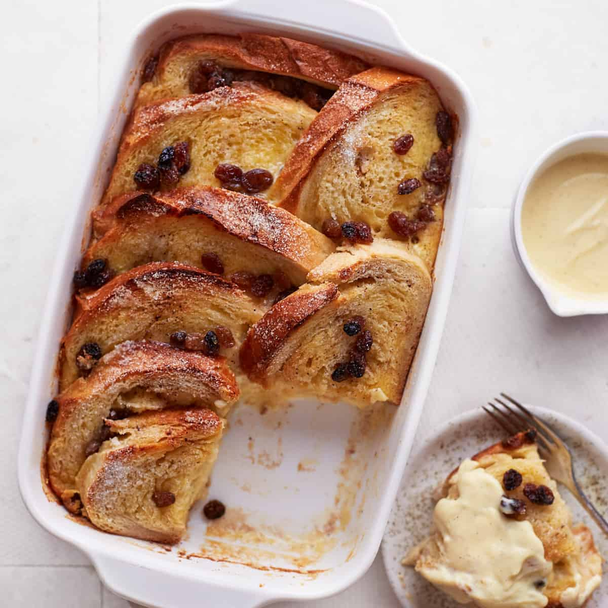 Decorative picture of baked bread pudding in a casserole from top