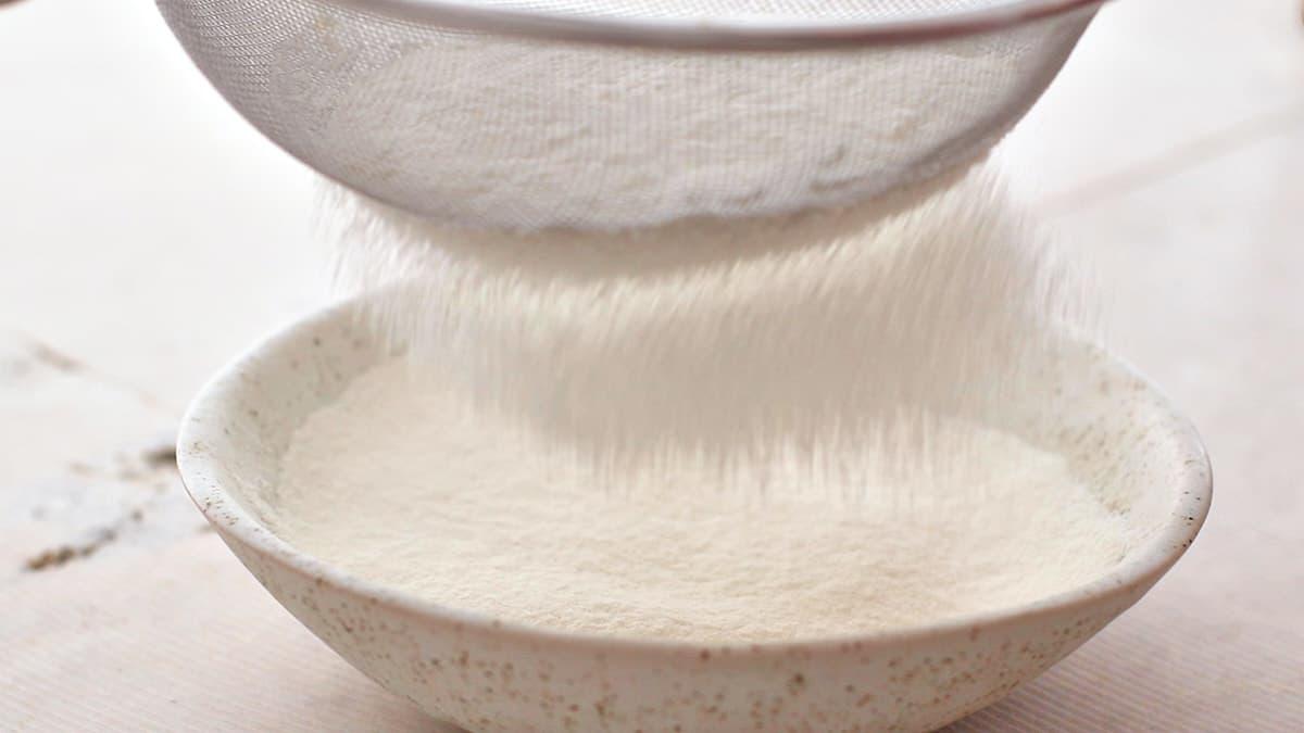 Sifting flour and sugar into a bowl