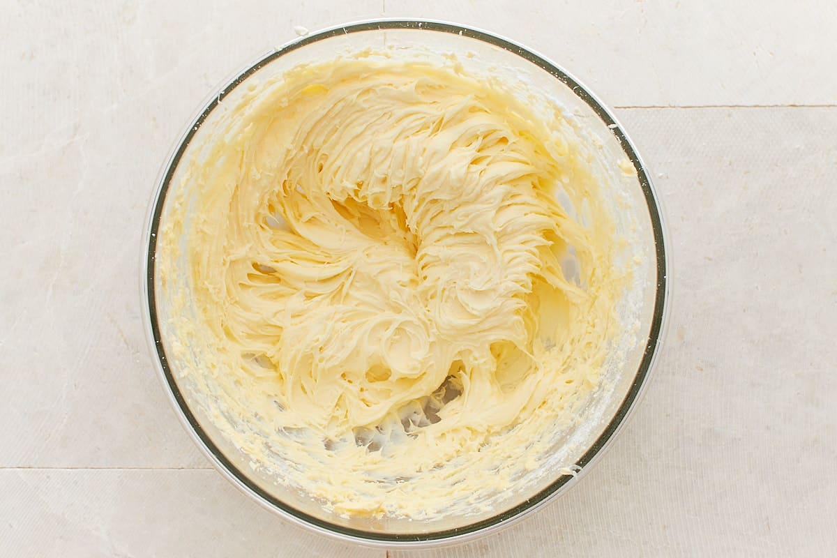 Mixed cream cheese frosting in a bowl