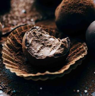 Bitten truffles on dark background