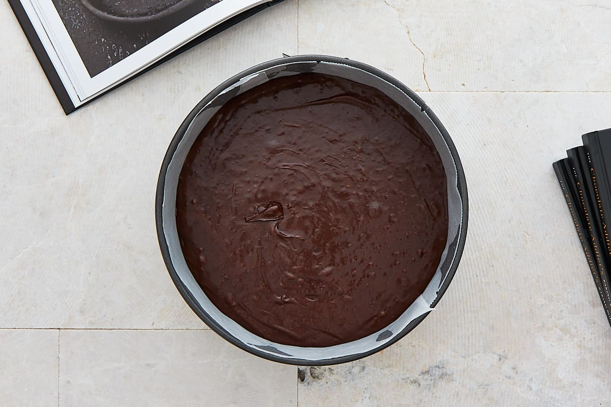 Unbaked chocolate batter in a springform pan