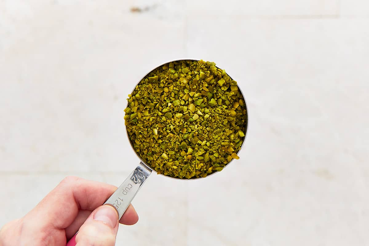 Ground pistachio in a measuring cup