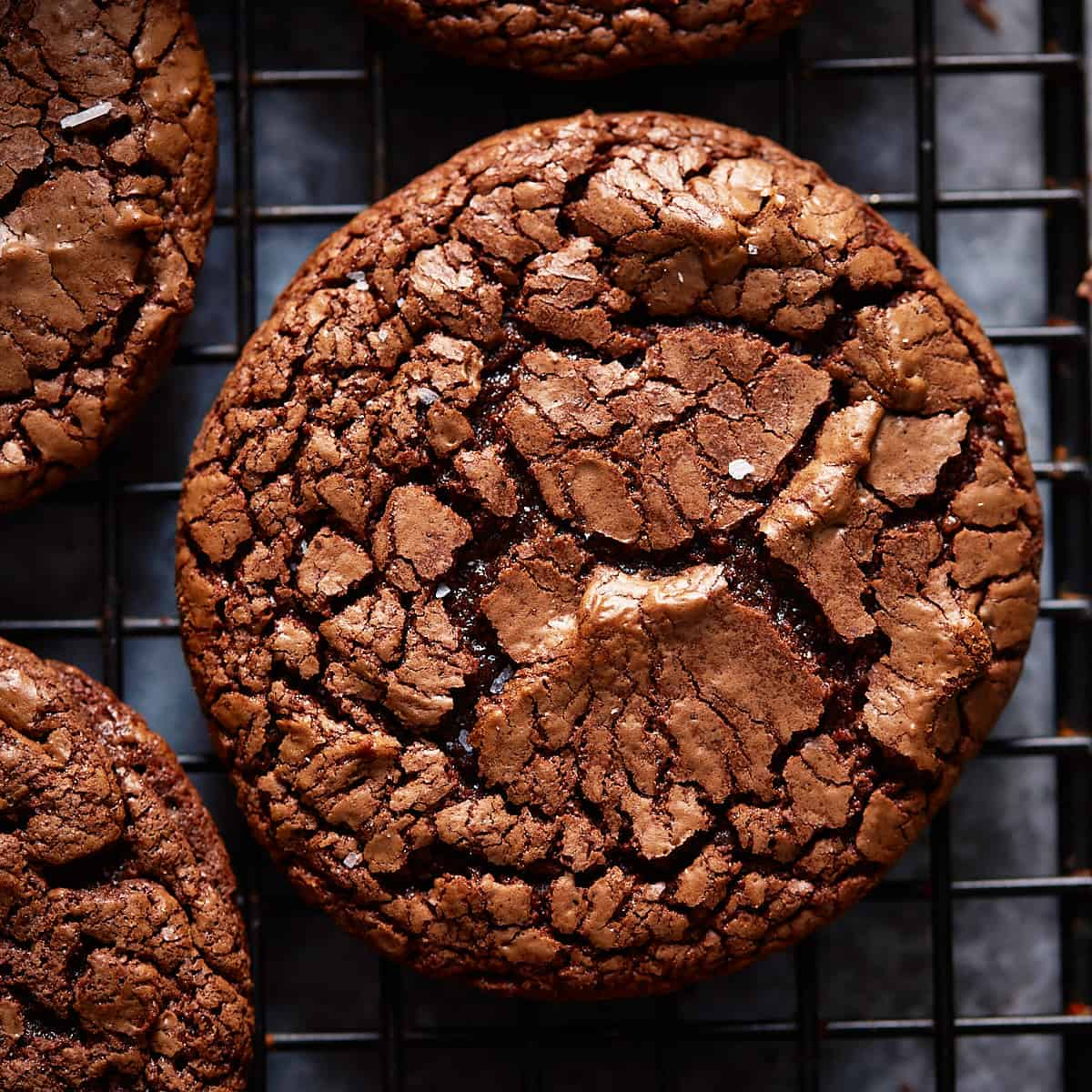 Close up of a baked and cooled brownie cookie on a cooling rack