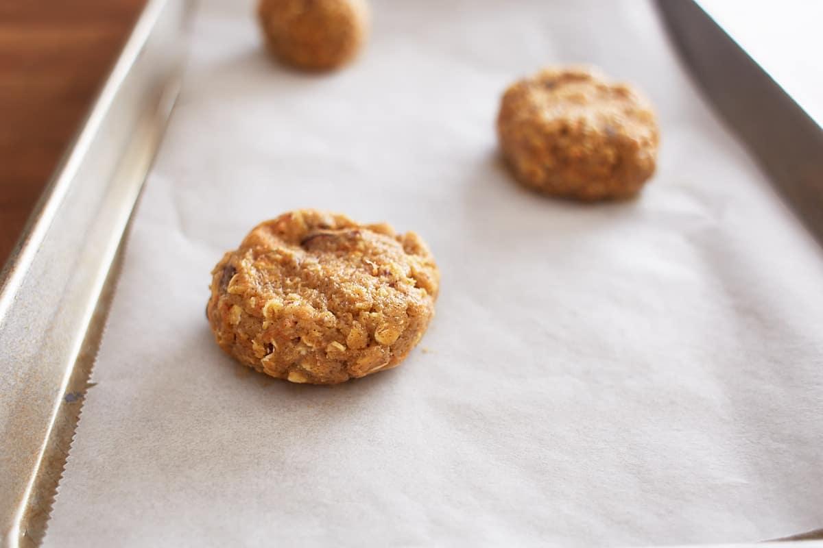 Flatten balls of cookie dough on a baking sheet