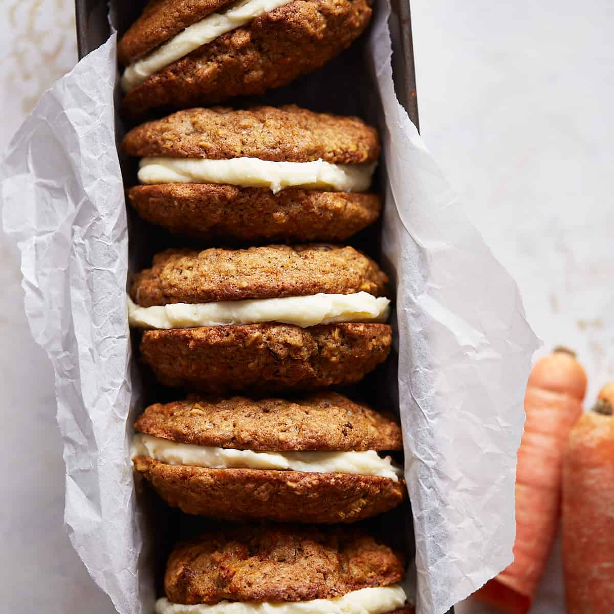 Carrot cookie sandwiches in a baking pan