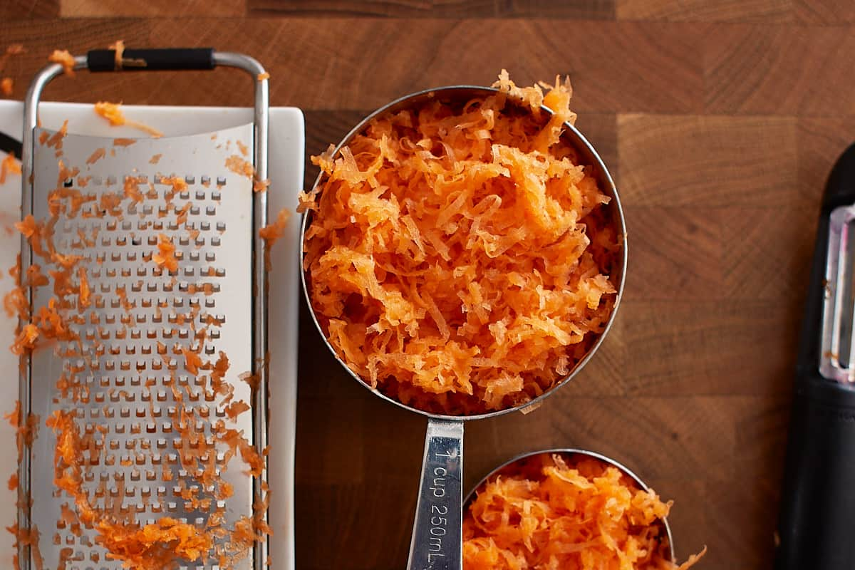 Grated carrots in a measuring cup