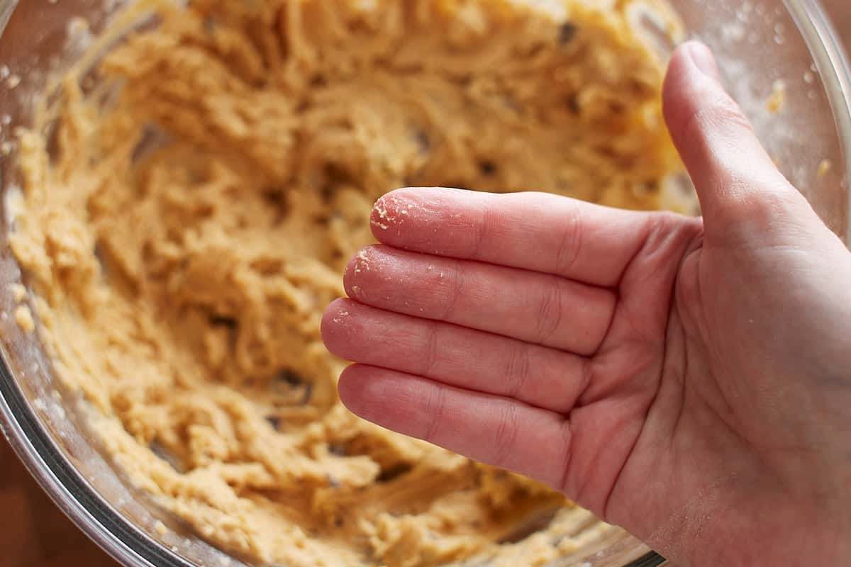 Cookie dough slightly sticking to fingers
