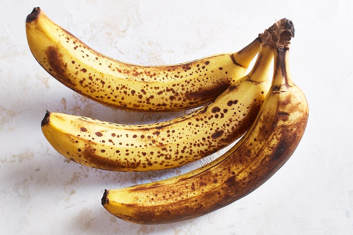Ripe bananas covered in brown specks