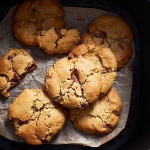 Baked cookies in an air fryer basket