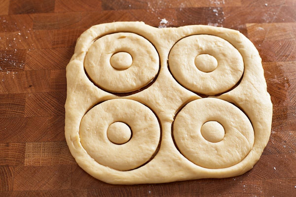 Cut donut dough on a surface