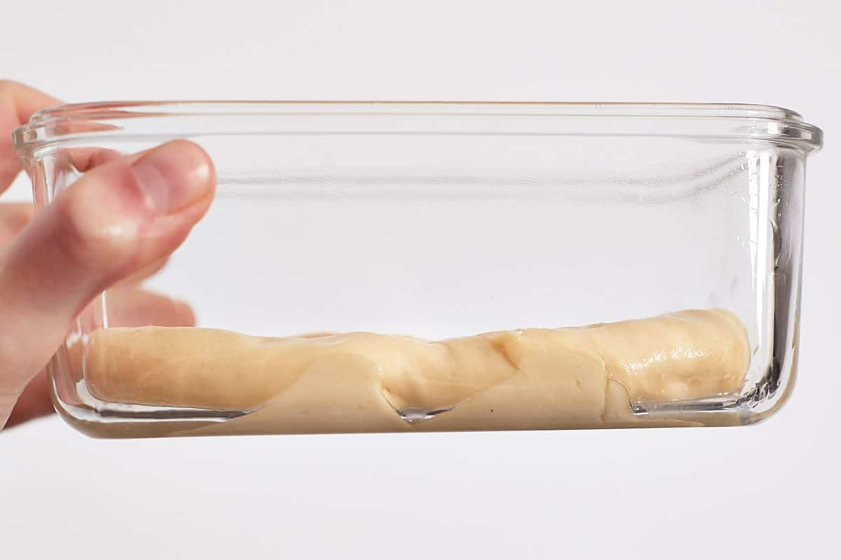 Unproofed dough in a glass container
