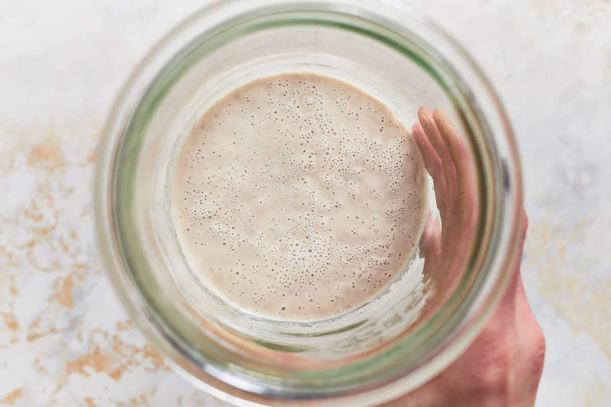 Fermenting flour and water in a jar with lots of bubbles