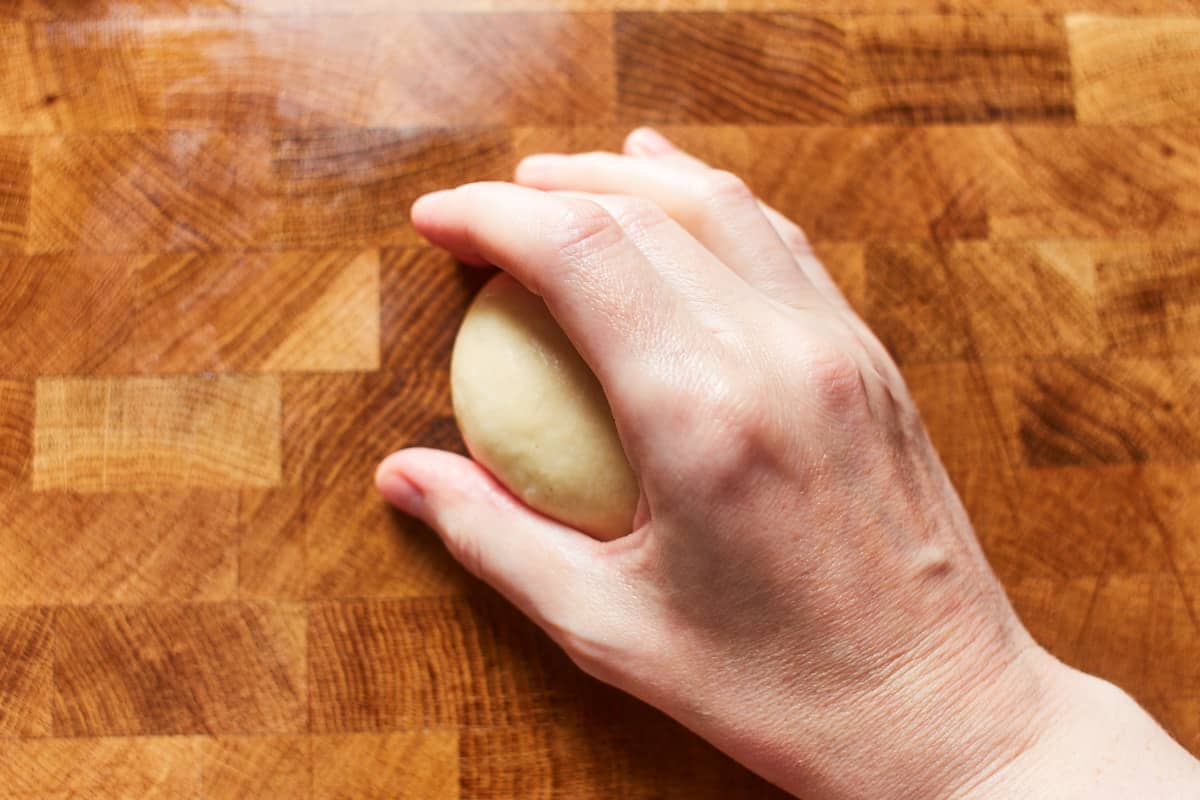 Cupping the dough with one hand