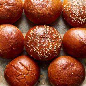 Baked brioche buns on a baking sheet