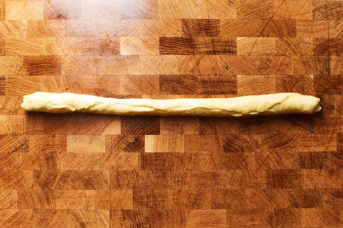 Sealed dough strand on a work surface