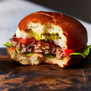 Half eaten hamburger on a cutting board
