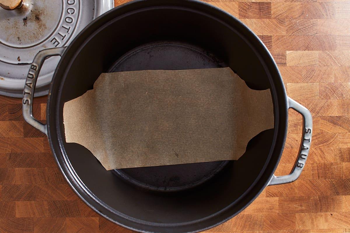 A strip of parchment paper in a dutch oven