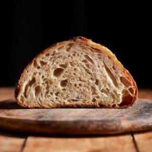 Bread cut in half on cutting board