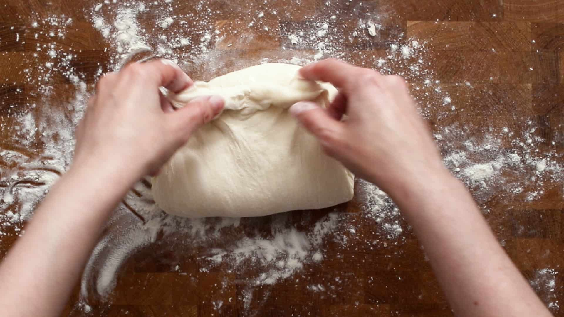 Folding the stretched dough onto itself