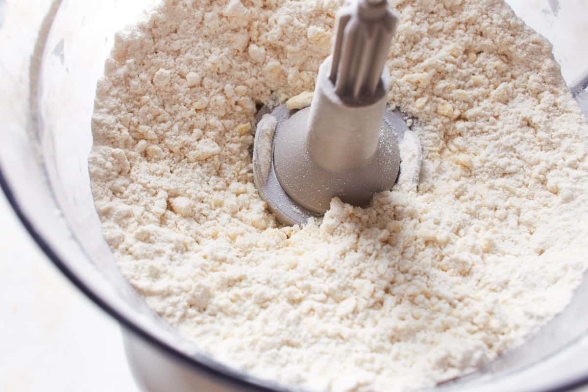 Flour, sugar, salt, and butter processed in a food processor