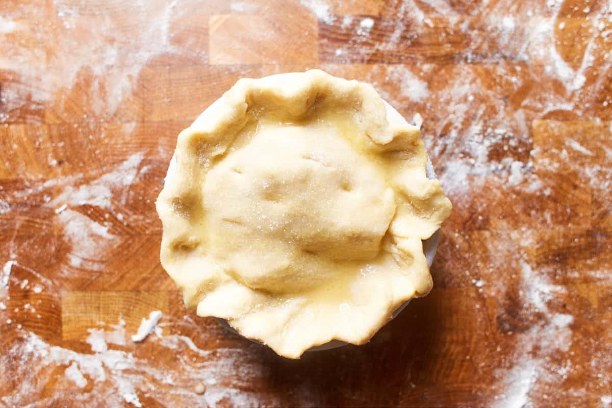 Unbaked apple pie in a ramekin