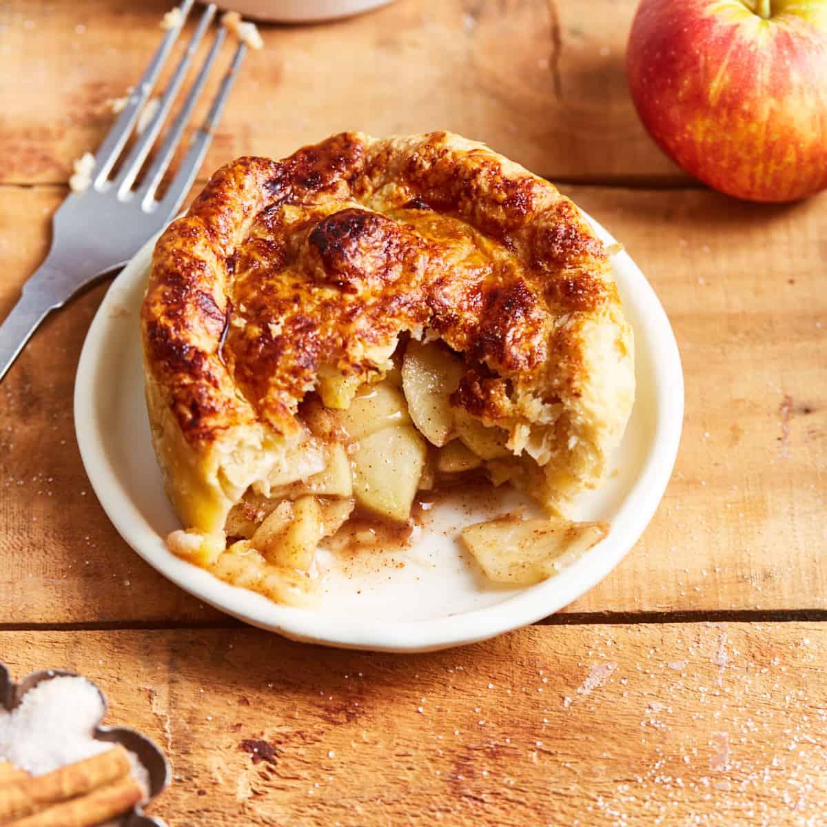 Half eaten mini apple pie on a plate