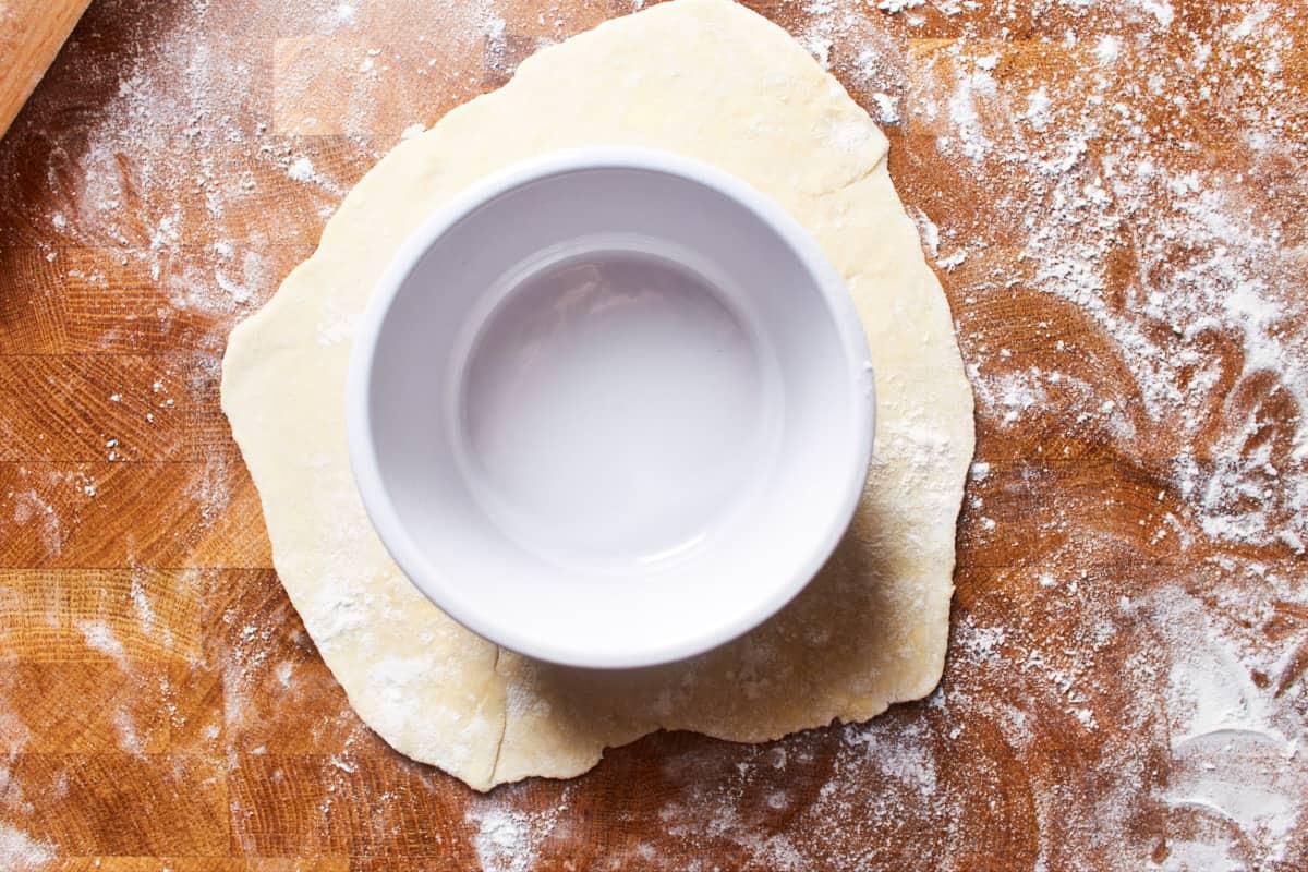 Ramekin placed on top of rolled crust