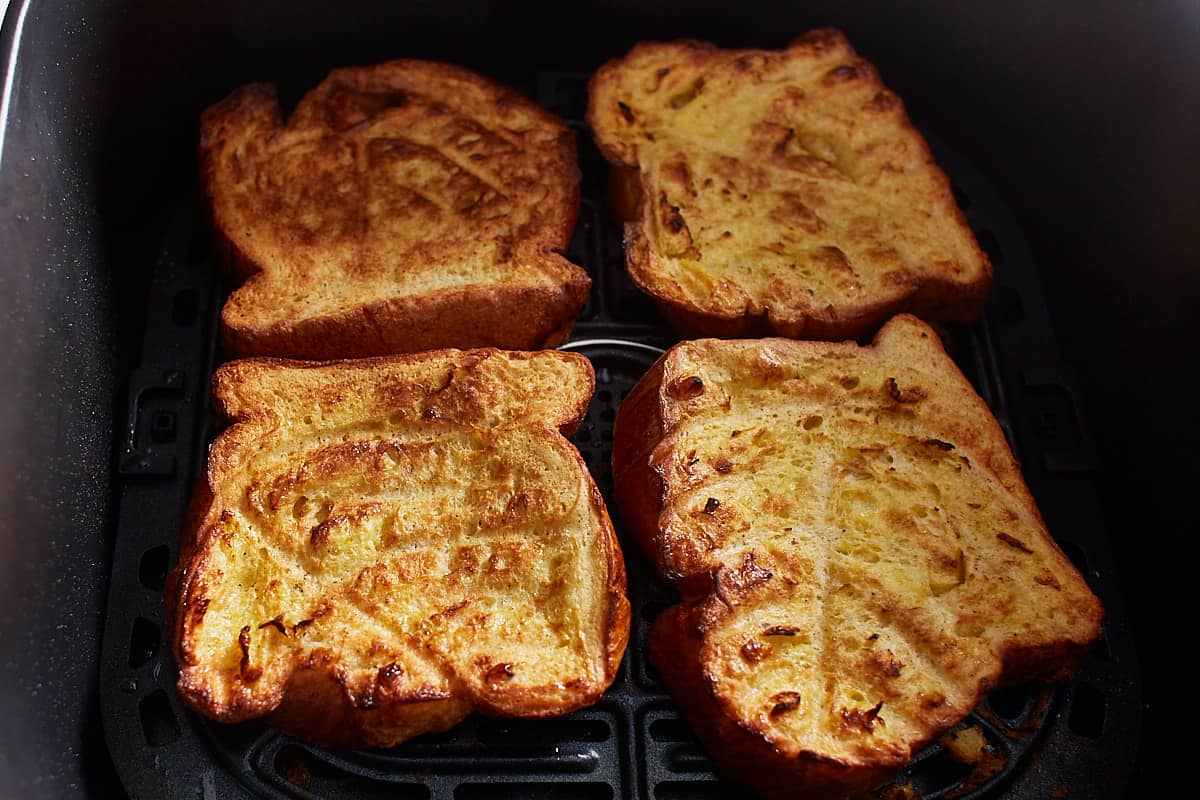 Half cooked toast slices in an air fryer